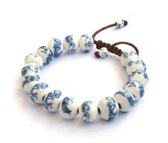 Hand Crafted Vintage Style Porcelain Dragon Beads Bracelet Ovalbuy http://www.amazon.com/dp/B006C18MJM/ref=cm_sw_r_pi_dp_1TDwub0P6W386