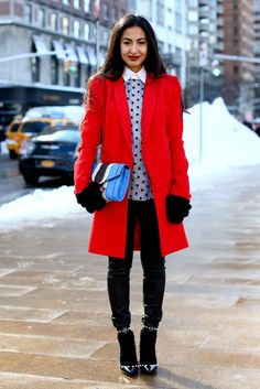 Here's a woman who's not afraid to take fashion risks—plain and simple. From the pairing of her bright red winter coat with a sky blue leather clutch, to her placing a strong polka dot pattern center stage, to wearing a pair of socks under her Valentino rockstud pumps—this girl isn't afraid to play around with putting an outfit together. Far from straightforward, she takes several wardrobe staples and wears them in an intruiging way.