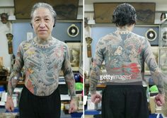 Japanese tattoo artist Horiyoshi III shows his tattoos on his body ...