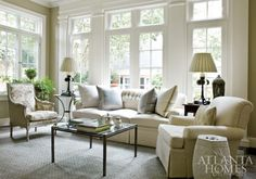 """Perfectly appointed in the same """"warm, but not cluttered"""" style as the rest of the house, the newly added sunroom is consistent with the home""""s color scheme with tints and shades of cream, blue and taupe."""