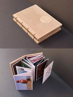 Llibre Homenatge A book with an engraved, wooden cover and exposed binding.