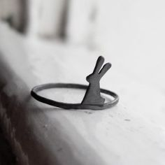 ring that fits two sizes (e.g. 5-6, 7-8) so that you can ensure a good fit and even wear your ring on different fingers. Each little bunny is cut out with a saw by hand from sterling silver sheet so they all have a unique look but I work very hard to make sure that they are as cute as possible! The bunny measures approximately 0.5 centimetres wide and 1 centimetre in height and is soldered onto a 1.4mm sterling silver hammered ring band. I then oxidize the little bunny ring to a fabulous…