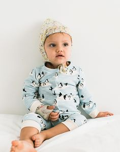 Baby Jammies! Cozy up your little babe with a soft, snap button, terry romper from Winter Water Factory. Baby boy is shown wearing his blue penguin romper with a confetti cake pom hat from Misha & Puff. Both available on the shop now!