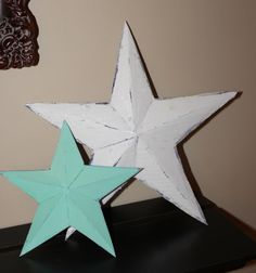 Super easy cardboard barn stars!  Oh. My. God.  Going to make so many of these.
