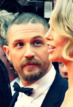 Tom Hardy with  Charlize Theron .  Mad Max Fury Road premiere in Cannes - May 14th 2015