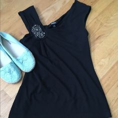 Express sleeveless top Beautiful black top. In used good condition, Very stretchy and comfortable, detailing in shoulder. Express Tops Tank Tops