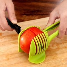 Easy to use Food Tomato Onion Vegetable Fruit Slicer Egg Peel Cutter Holder Clip. Add the tomato slicer along each gap from the top down the you could cut it into pieces. Just cut to the vegetables or fruits in the slicer, can cut out up to Kitchen Tools And Gadgets, Cooking Gadgets, Cooking Tools, Kitchen Hacks, Cooking Equipment, Home Gadgets, Spy Gadgets, Cooking Fish, Travel Gadgets