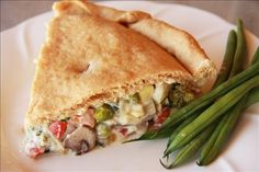 Veggie Pot Pie. For a faster recipe, use Amy's Cream of Mushroom soup and organic crescent rolls rather than the cream sauce and pizza dough.