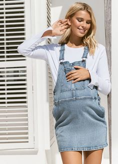 A denim pinafore with an understated and enduring appeal that is effortless cool and comfy and looks just as good without a bump. Denim Pinafore, Pinafore Dress, Stylish Maternity, Maternity Wear, Long Shorts, Size Model, Overall Shorts, Stretch Denim, Bump