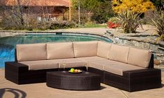 Wicker outdoor furniture with pieces that join into an L-shaped couch with cushions and and table can be rearranged into many configurations