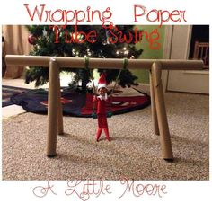 Elf on the Shelf made a swing using wrapping paper tubes, how cool....