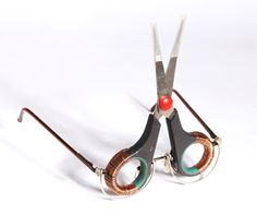 Scissors, 2011  13 x 11cm, arm length: 12cm  Materials: Scissors, copper wire, glasses frame