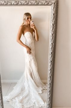 This curve-hugging, layered lace wedding dress is beautifully detailed with a plunging sweetheart neckline, flattering princess seams, and all over intricate beadwork and sequins. Complete with a beautiful scalloped chapel train. | #beadedweddingdress #modernweddingdress | Style CWG878 | Shop this dress and more at davidsbridal.com | Photo by: @amandalynrose Stunning Wedding Dresses, Glamorous Wedding, Glitter Bridesmaid Dresses, Informal Weddings, Lace Mermaid Wedding Dress, Tea Length Dresses, Floral Wedding, Lace Wedding, Davids Bridal