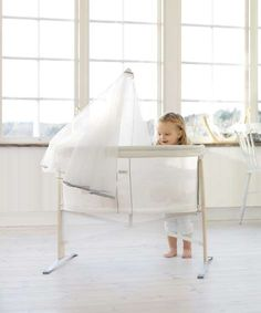 Baby Bjorn translucent bassinet offers mommy, daddy and older siblings a view of the new baby