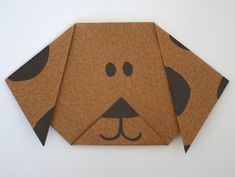 Folded paper dog.  Use red paper and make a Clifford!
