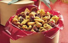 Curried Snack Mix - Chewy raisins and dried cranberries are sweet surprises in a zesty mix of crunchy cereal, pretzels and cashews. Trail Mix Recipes, Snack Mix Recipes, Dog Food Recipes, Snack Mixes, Cereal Mix, Chex Cereal, Cheerios Cereal, Cheerios Recipes, Perry Recipe