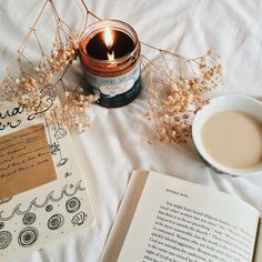 Frostbeard Reading at the Café candle, books, journal scribbles and tea