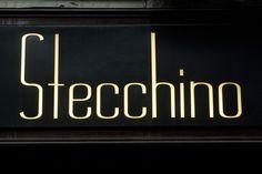 A thin sans serif type used in a sign. The letters are illuminated, creating a formal and classy look.