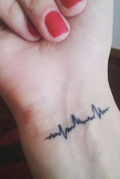 23 Heartbeat Tattoos That'll Leave You Breathless