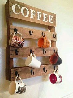 This awesome wooden pallet cup hanging shelf will surely clear up the mess from your kitchen and let you access your crockery or necessary items more easily. It is simple and beautiful idea. Just clean and disinfect the pallet and retain its original and natural texture.nail it in the wall and attach a few hooks.