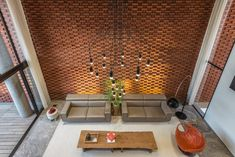 Rippling red brick facade shades house in Surat by Design Work Group Lobby Interior, Patio Interior, Dream Home Design, House Design, Brick Face, Brick Architecture, Indian Architecture, Residential Architecture, Courtyard House Plans