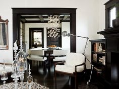 big! black! trim!  spectacular. that dining table with benches is off the hook.
