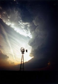 coffeenuts:  ♥ A windmill and supercell storm in Leedey, Oklahoma, USA. And a lingering chemtrail.