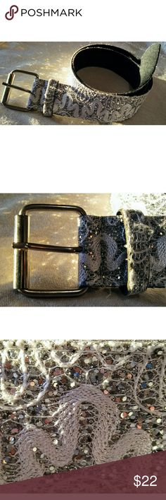 "Disco Queen Glitter Belt.  RARE!  NWOT. Beautiful and unique. Intricate silver & gray woven design topped with glitter accents for a shimmery effect. Silver tone buckle. Black faux leather backing. Wide belt style. Total length- 38"". 33"" equivalent to size S/M (see last photo for sizing chart). Width- 1.5"".  Original sample.  Rare item.  New- without tags.  Shine day - or night - with this one-of-a-kind statement piece. Accessories Belts"