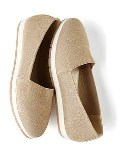 Shimmering metallic thread weaves its way through out our wide-width slip-on shoes. The front elastic top allows you to easily slip on and off this comfortable accessory. Two toned, cushioned insole gives you all-day comfort. For your comfort, Catherines flats and flip-flops come in wide width sizes to better fit the plus size woman. catherines.com