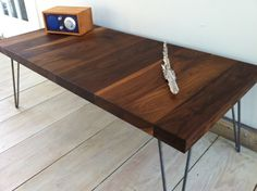 Mid century modern coffee table featuring black walnut top and hairpin legs. on Etsy, $299.00