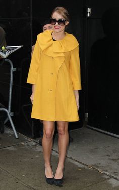 : While out and about in NYC, Conrad worked a bright yellow coat, complete with ruffle detail.Lesson from Lauren: never underestimate the power of a statement coat.