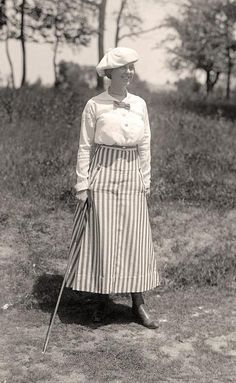 Miss Edith Gordon playing golf, 1916  Another shot: