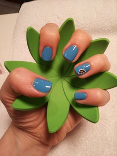 A great blue for spring with a nail art flower.