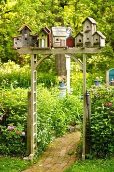 village garden arbor - I just have to do this in my backyard! - Gardening In LightsBirdhouse village garden arbor - I just have to do this in my backyard! - Gardening In Lights Yard Art, Brick Path, Brick Garden, Wooden Garden, Recycled Garden, Recycled Crafts, Recycled Materials, Garden Cottage, Garden Houses