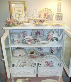 Shabby white cabinet filled with pink & white lovelies for sale...Olde Towne Antiques & Upholstery.