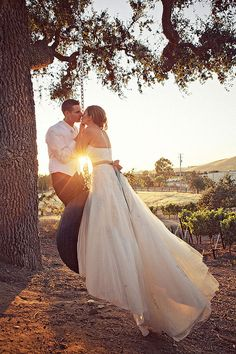 Bride & groom tire swing photo idea. So cute for those rustic themed weddings, which I love. I WISH there was a swing or tire swing at our venue!