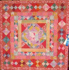 Quilt with Kaffe Fassett fabric at an October 2011 quilt show, combining florals with stripes.  Photo by Scraps and Thread Tales