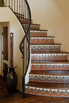 Spanish tile stairs- Easy to clean, and shabby chic gorgeous. Need!