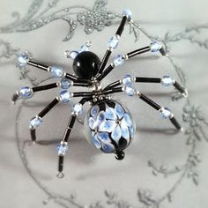 spider with lamp work bead for ornaments - Legend of the Christmas Spider http://www.kraftmstr.com/christmas/books/spider.html