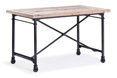 The Presido Height Desk rests on 4 metal wheels. The frame is metal painted black. The top is fir wood left in a natural oak colour.