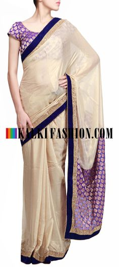 Buy Online from the link below. We ship worldwide (Free Shipping over US$100)  http://www.kalkifashion.com/beige-foil-saree-featuring-with-contrast-navy-blue-border.html Beige foil saree featuring with contrast navy blue border