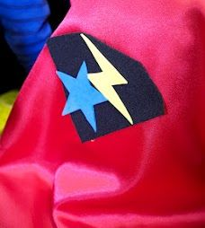 I had capes made of satin with Velcro closures. Each kid got to choose a brightly-colored cape and then decorate it with cut-out shapes made from sticky-back felt. This served as a fun activity and a party favor too.