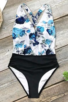 f044a2bfac Add some floral flair to your swimwear collection with this Blue Floral and  Black Ruched One