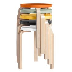 A three-legged wooden stool that is simple, stackable and colorful.