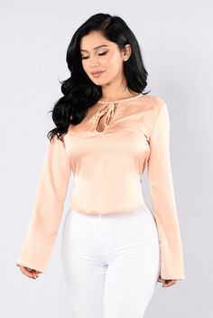- Available in Blush - Satin Blouse Top - Round Neckline - Neck Tie - Key Hole Front - Long Bell Sleeves - Rounded Hem - Made in USA - 100% Polyester