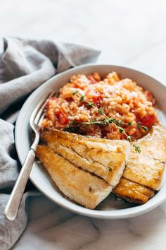 Creamy Tomtato Risotto with Pan Fried Barramundi! Slow-simmered tomato parmesan risotto paired with crispy golden brown fish. YUM! Sponsored by @AustralisBarramundi | http://pinchofyum.com