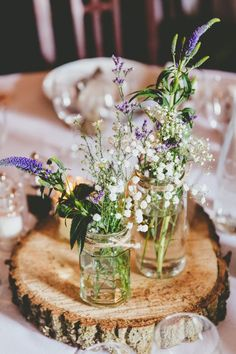 Wildflowers Centrepiece Log Jars Twine Purple White Relaxed Fun Rustic Countryside Barn Wedding / http://www.deerpearlflowers.com/ideas-of-using-twine-for-rustic-wedding/