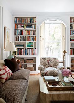 animal print sofa, colorful books; patterned chair