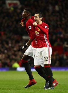 Paul Pogba of Manchester United celebrates after scoring a goal to make it 21 with Henry Mkhitaryan of Manchester United during the Premier League...