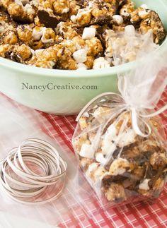 S'mores Popcorn (Semi-Sweet Chocolate Chips, Crushed Graham Cracker Crumbs, Caramel Popcorn, White Chocolate Chips, Mini Marshmallows.)  l  Nancy Creative.com